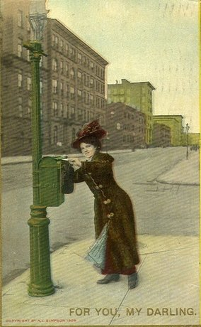 Woman putting a letter in a post box, United States of America >